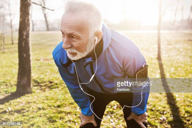 close up of a senior man jogging - sportsperson stock pictures, royalty-free photos & images