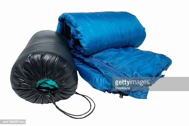 Close up of a sleeping bag and a tent
