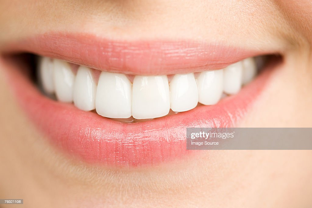 Close up of a smiling woman : Stock Photo