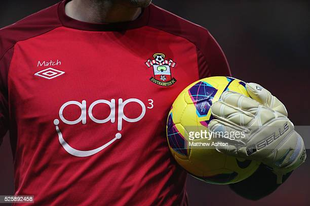 Close up of a Southampton goalkeeper holding a match ball