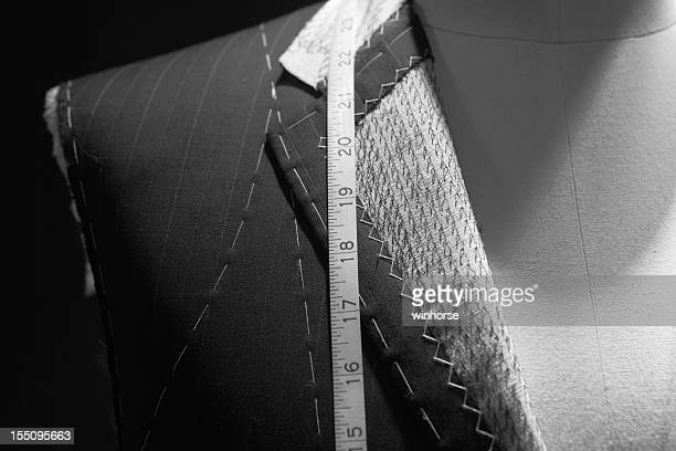 Close up of a suit and measure tape of a tailor