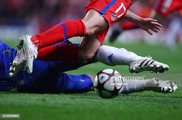 Close up of a tackle during the UEFA Champions League group match between Chelsea and Atletico Madrid at Stamford Bridge in London England