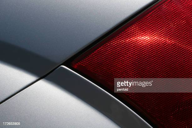 Close up of a tail light on a silver vehicle