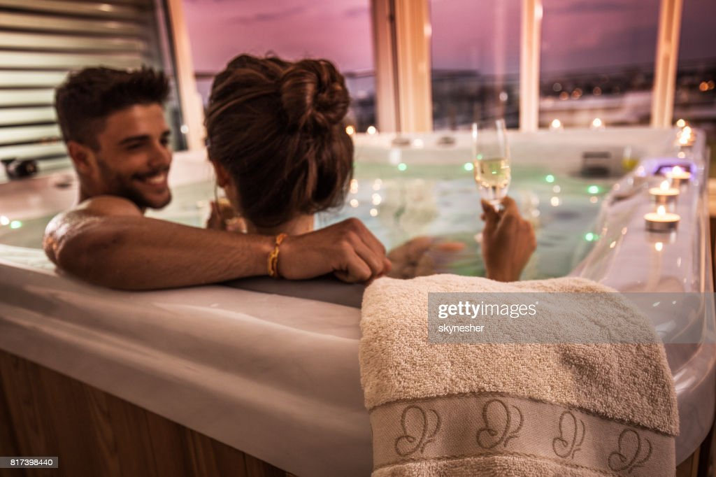 Close up of a towel on a hot tub with couple in it. : Stock Photo