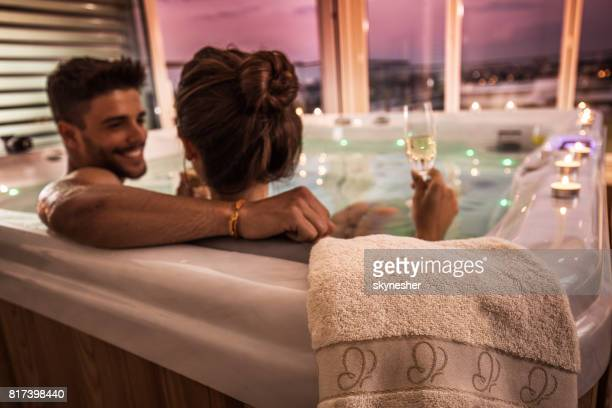 close up of a towel on a hot tub with couple in it. - hot tub stock photos and pictures