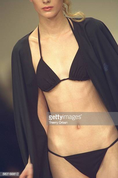 Close up of a two-piece swimming costume and a shawl.