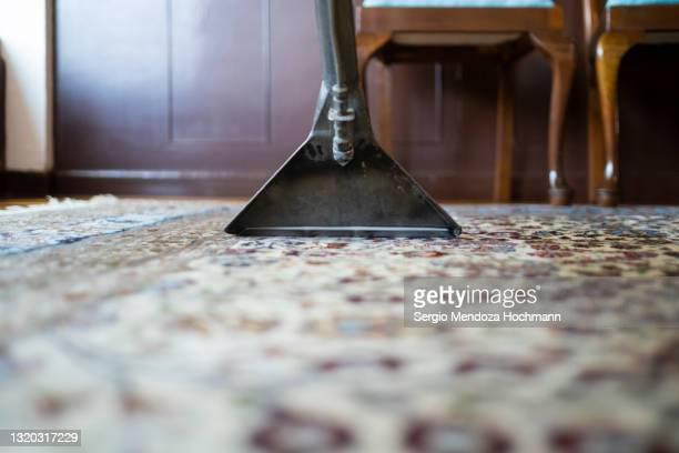close up of a vacuum cleaner on a carpet - industrial hose stock pictures, royalty-free photos & images
