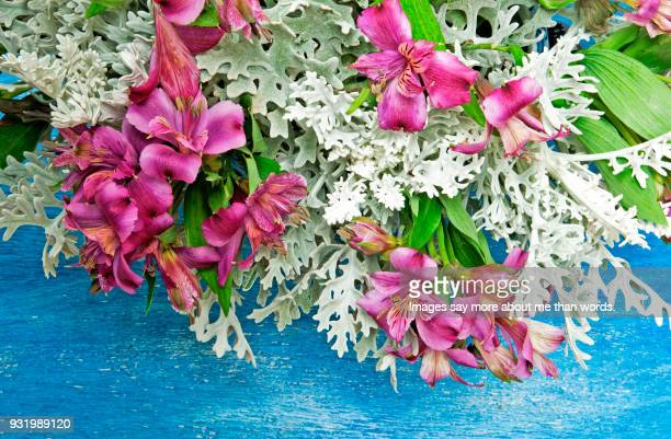 Close up of a very colorful flower arrangement.
