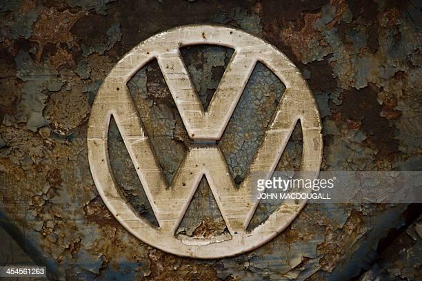 Close up of a VW logon on a weatherbeaten Volkswagen T1 van built in 1951 on display at a Volkswagen workshop specialised in restoring vintage T1 T2...