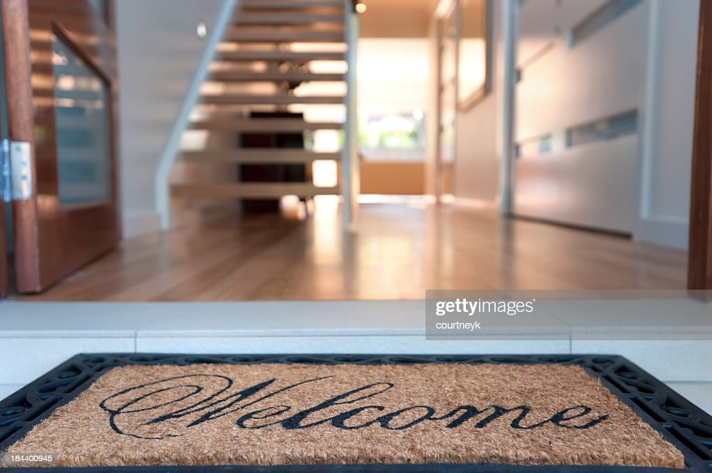 Close up of a welcome mat in an inviting house : Stock Photo