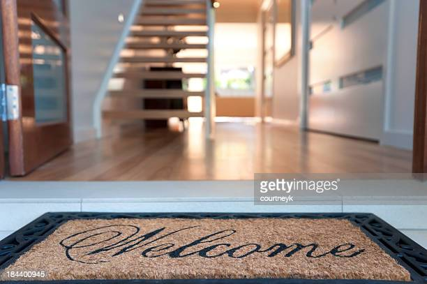 close up of a welcome mat in an inviting house - greeting stock pictures, royalty-free photos & images