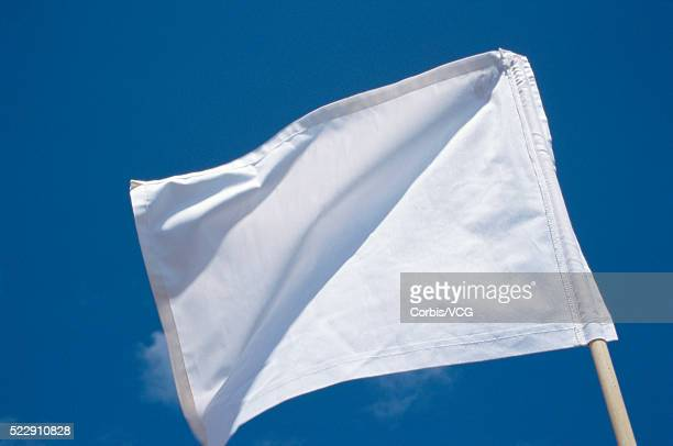 Close up of a white flag against blue sky