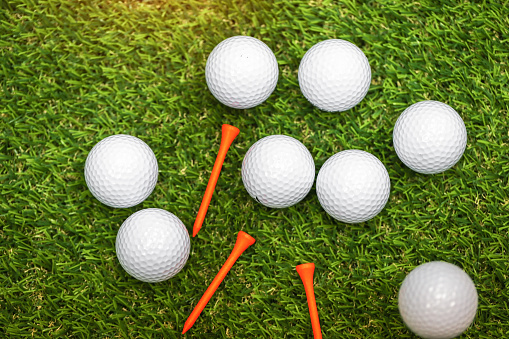 Close up of a white golf ball on green background - gettyimageskorea