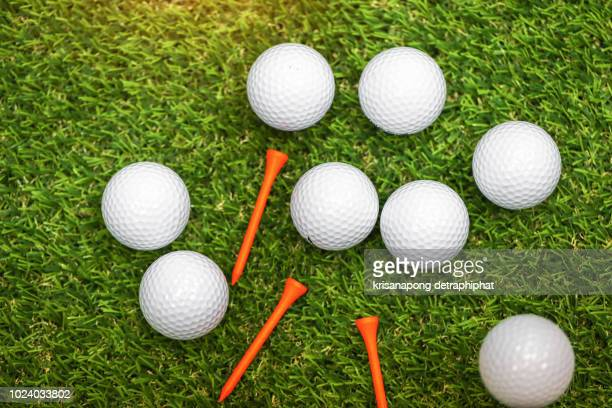 close up of a white golf ball on green background - golf ball stock pictures, royalty-free photos & images