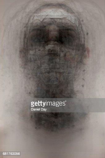Close up of a woman face hidden by a mask of news paper over her face