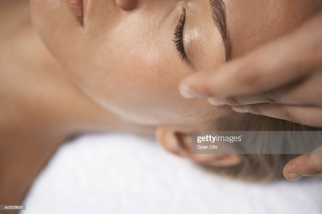 Close up of a Woman Getting a Face Massage : Stock Photo