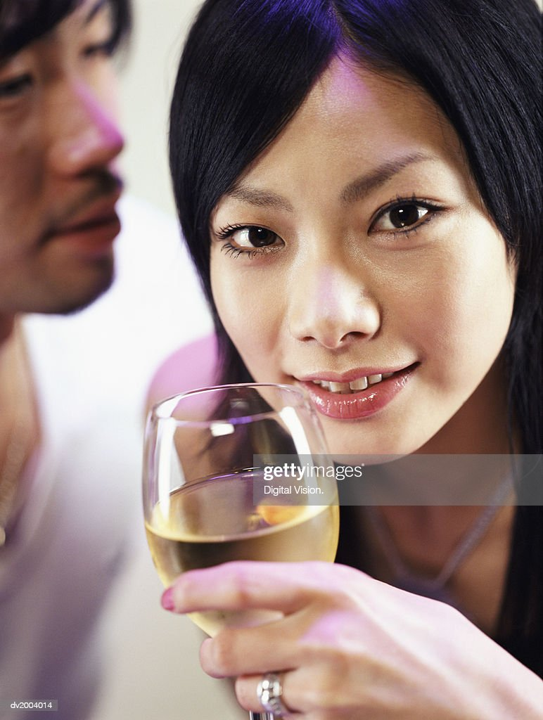 Close up of a Woman Holding a Glass of White Wine : Stock Photo