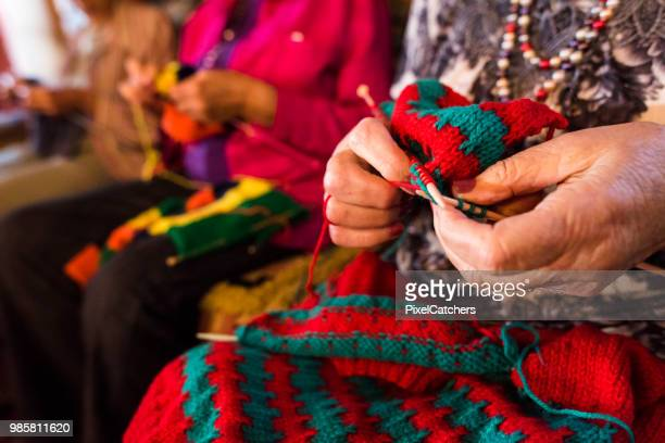 close up of a woman knitting - knitting stock photos and pictures
