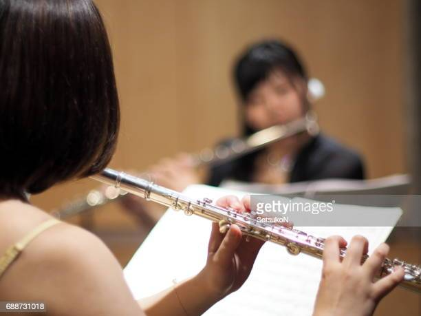 Close Up of a Woman Playing a Flute