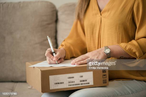 Close up of a woman receiving her package