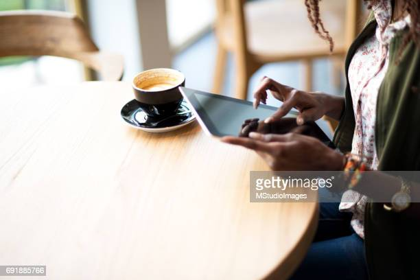 Close up of a woman using digital tablet