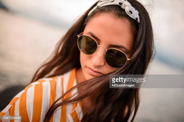 close up of a woman wearing sunglasses. - personal accessory stock pictures, royalty-free photos & images