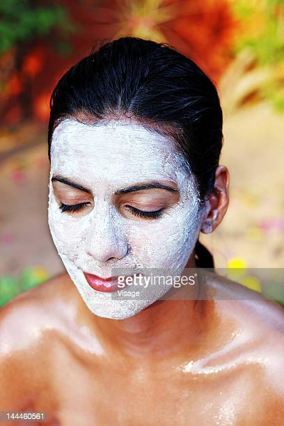 Close up of a woman with a face mask