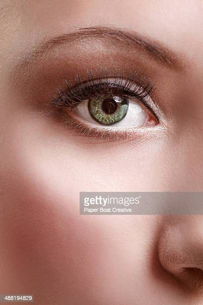 Close up of a woman with clear green eyes