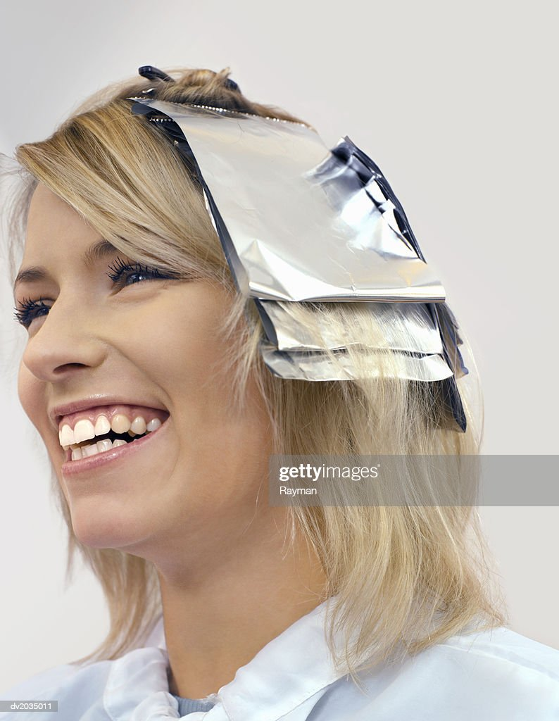 Close up of a Woman With Foil in Her Hair : Stock Photo