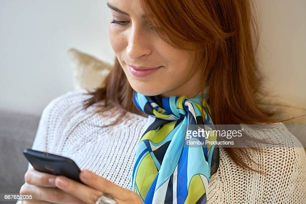 Close up of a woman with phone