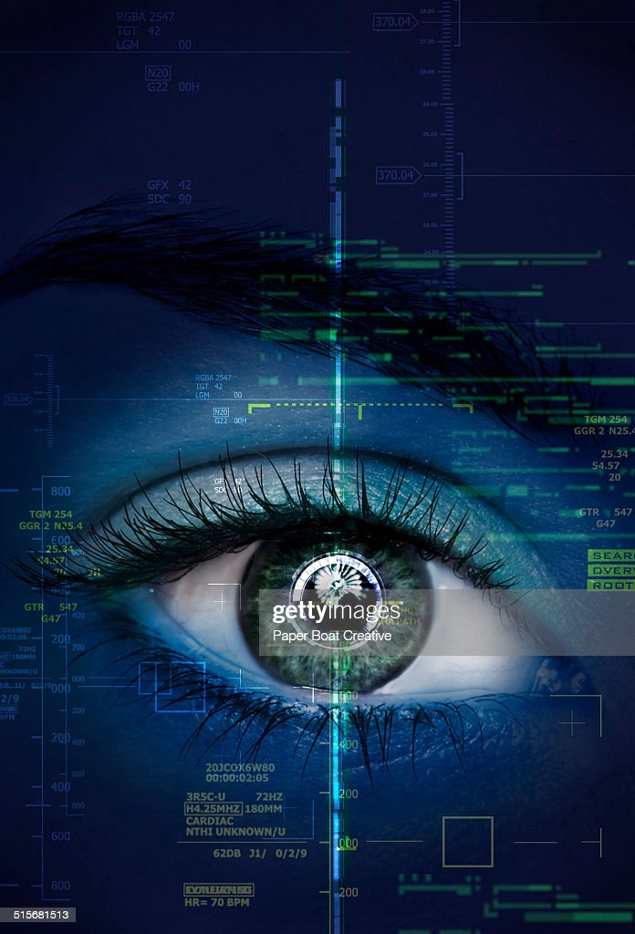 close up of a woman's eye with graphics and scans : Stock Photo