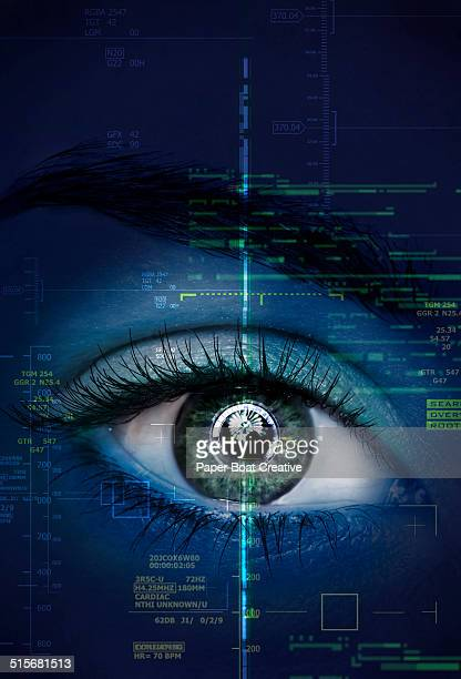 close up of a woman's eye with graphics and scans - green eyes stock pictures, royalty-free photos & images