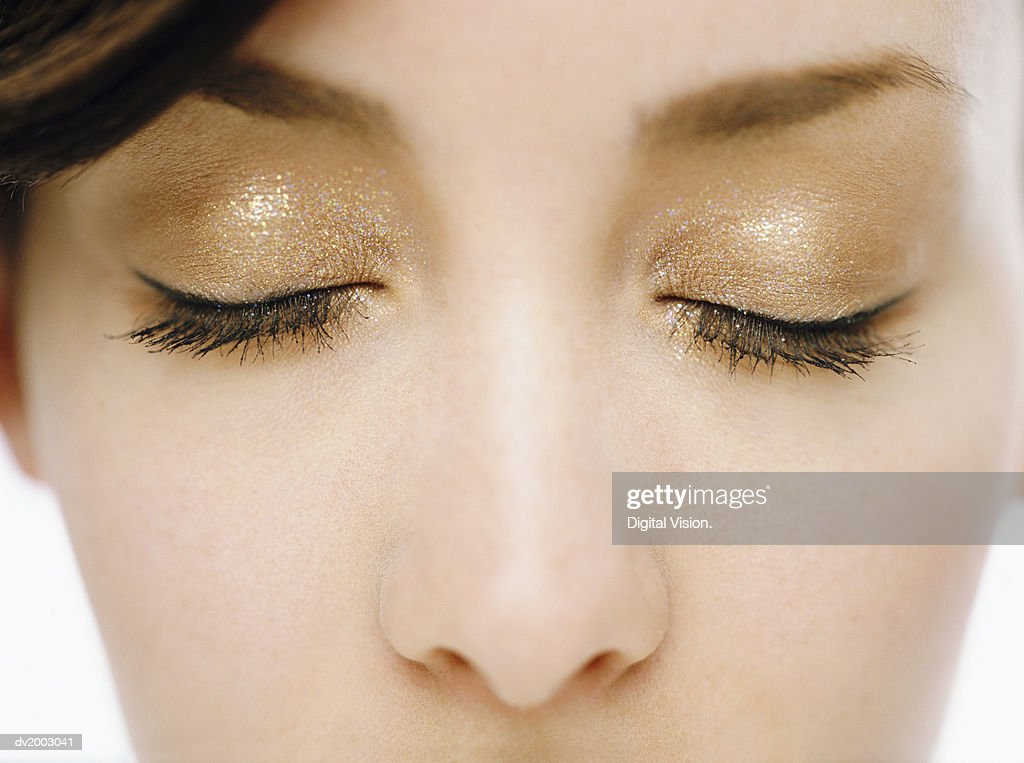 Close up of a Woman's Eyes With Golden Make Up : Stock Photo