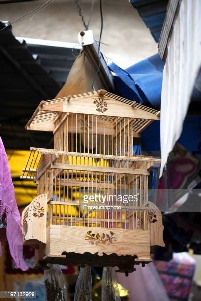 close up of a wooden bird cage for sale in the market. - emreturanphoto stock pictures, royalty-free photos & images