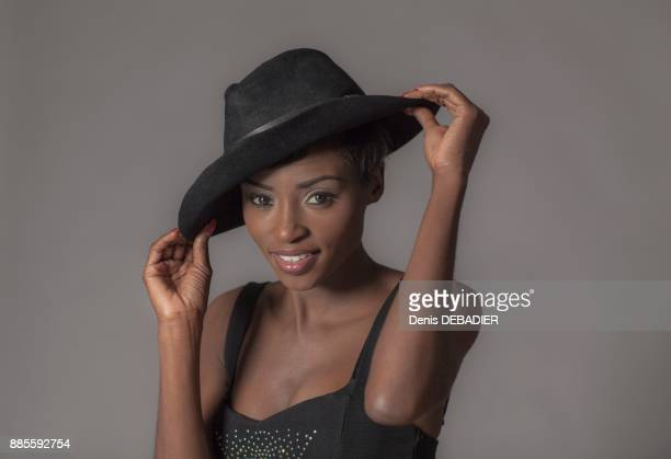 Close up of a young attractive African women with hat