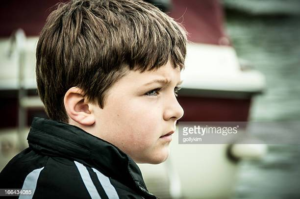 Close up of a young boy contemplating