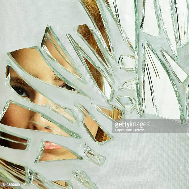 Close up of a young lady looking through glass
