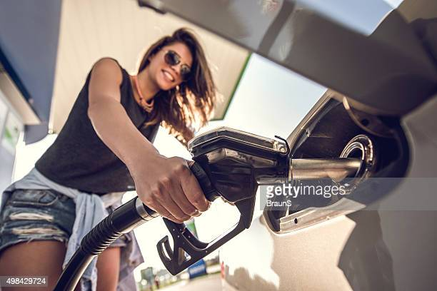close up of a young woman at gas station. - gas tank stock photos and pictures