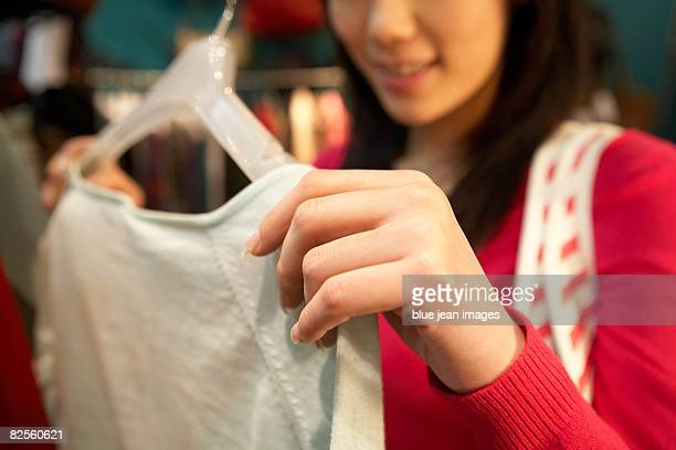 Close up of a young woman shopping.