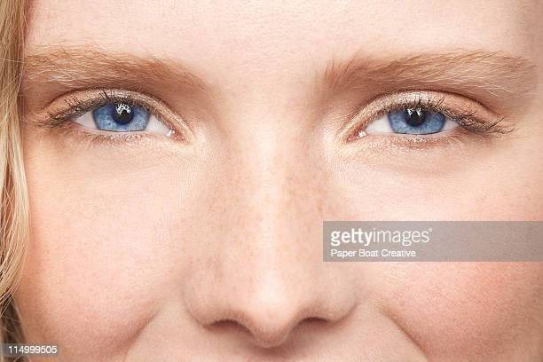 close up of a young woman with bright blue eyes