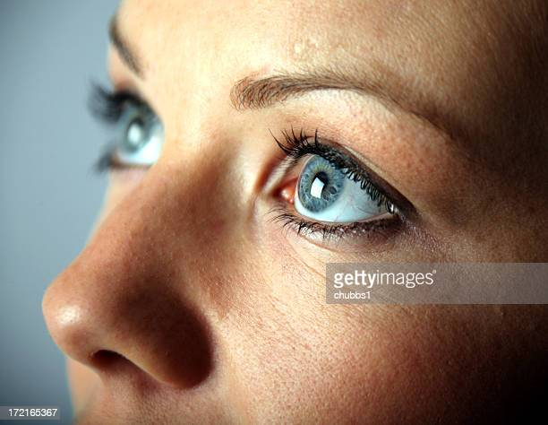 A close up of a young woman's blue eyes