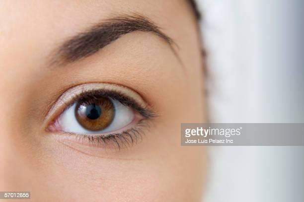 close up of a young woman's eye - eyelid stock photos and pictures