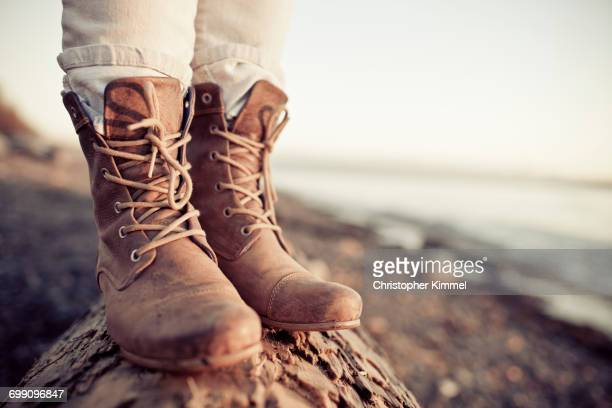 close up of a young womans leather boots during a trip to white rock beach - leather boot stock pictures, royalty-free photos & images