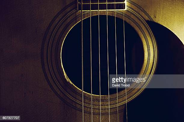 Close up of acoustic six string guitar