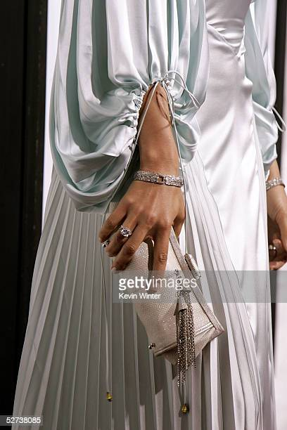A close up of actress Jennifer Lopez ring jewelry and hand bag as she arrives at New Line Cinema's Premiere of Monster In Law at the Mann National...