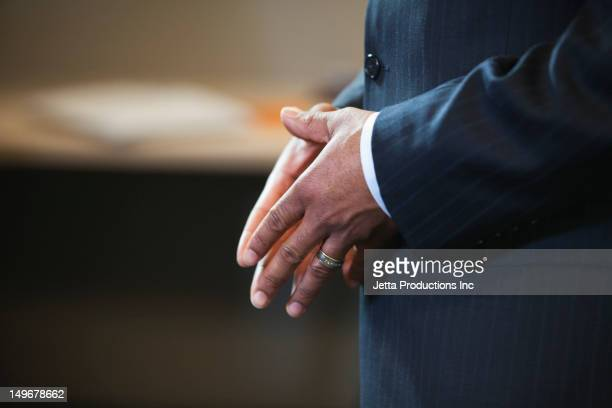 Close up of African American businessman's hands