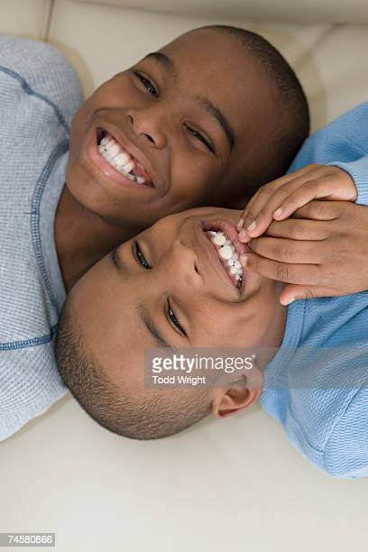 Close up of African brothers smiling