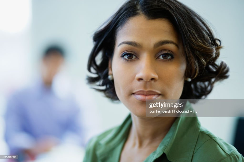 Close up of African businesswoman looking serious : Stock Photo