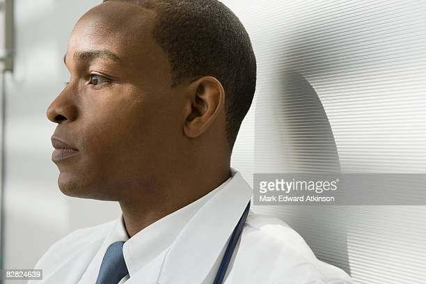 Close up of African doctor looking pensive