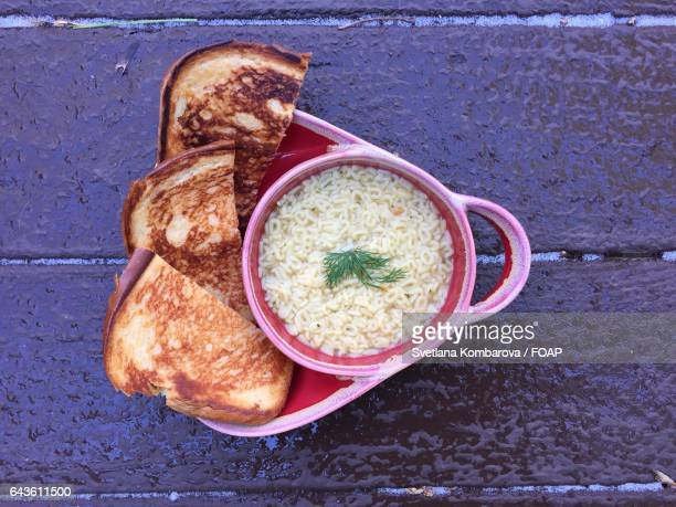 Close up of alphabet soup and grilled cheese sandwich